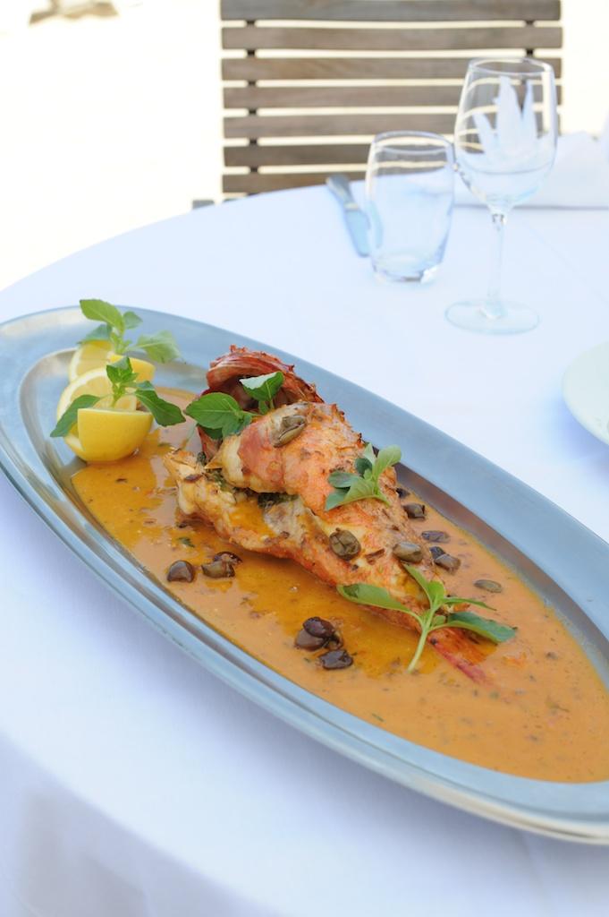 Photographie culinaire d'un chapon à la provençale