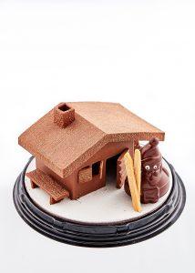 photo culinaire d'un chalet en chocolat